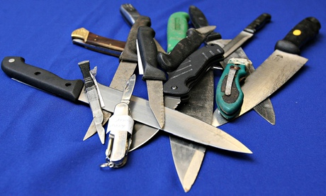a pile of knives on a blue table cloth